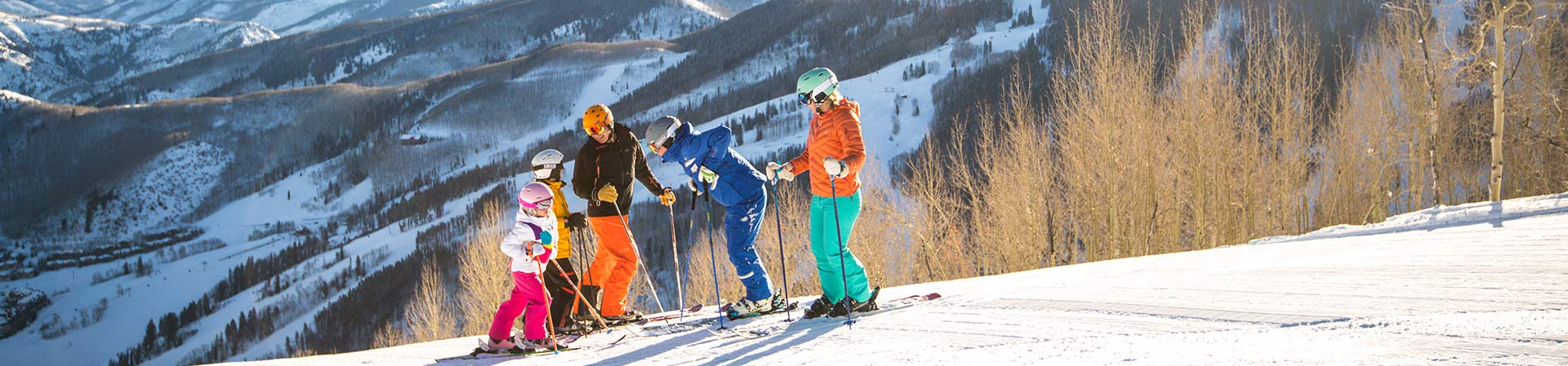 Family skis with instructor at Beaver Creek Resort, 1920x450